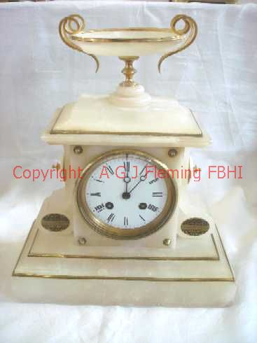 Front view of Alabaster clock with dish