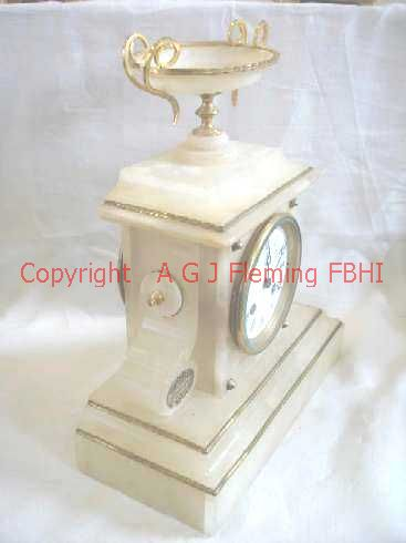 Left view of Alabaster clock with dish
