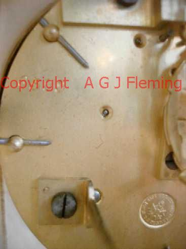 Stamps on back plate of Alabaster clock with dish