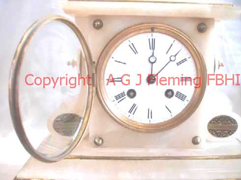 Dial of Alabaster clock with dish