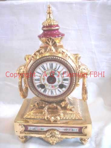Front view of gilt mantel clock
