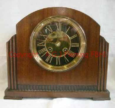 Front view of mantel clock with French rack strike on gong movement