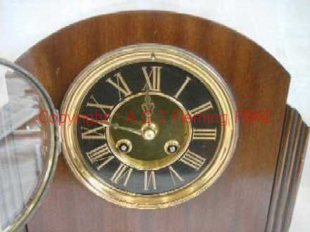 Dial of mantel clock with French rack strike on gong movement