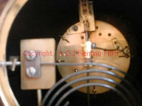 View of mechanism of mantel clock with French rack strike on gong movement
