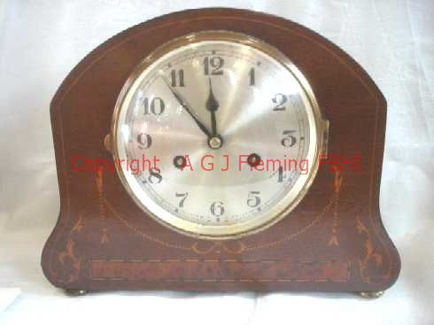 Front view of mantel clock with German rack strike on gong movement