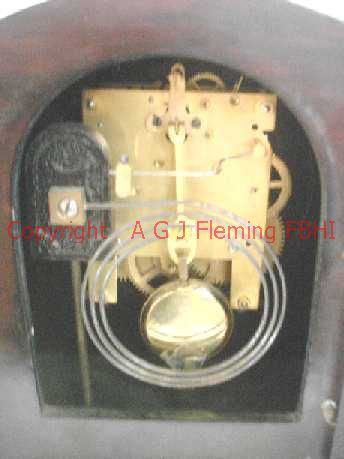 Inside view of mantel clock with German rack strike on gong movement